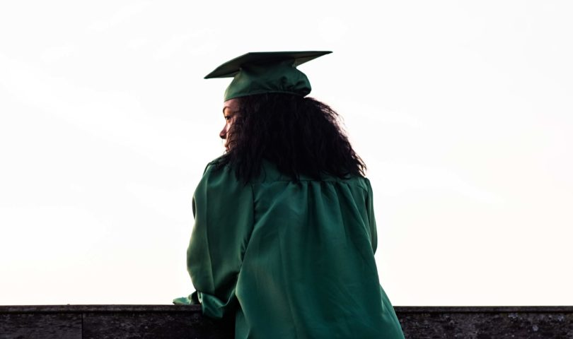 a graduate looking off into the distance